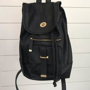 Faux leather backpack purse with gold accents